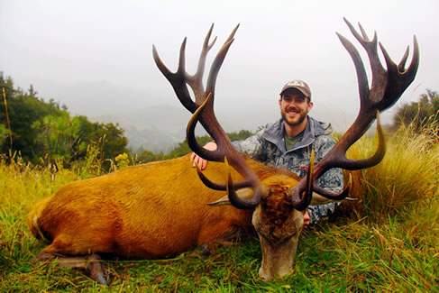 Tyler Shanks with a SCI gold medal wild red stag